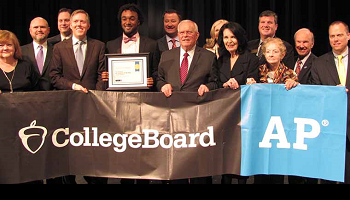 Mr. Wilbanks and board members holding College Board AP banner